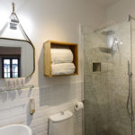 Sublime luxury walk-in rain shower and monogrammed White Company bathsheets in luxury Tuscan holiday rental